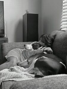 dog cuddling woman